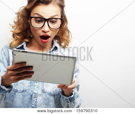 lifestyle and people concept: happy teenage girl wearing glasses with tablet pc computer