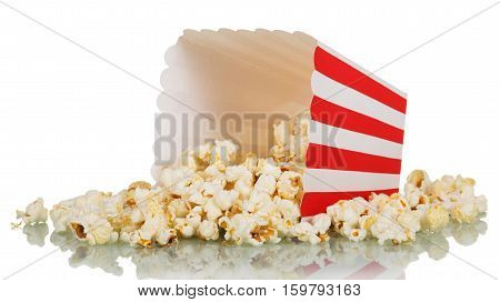 Popcorn spilled from square striped box isolated on white background