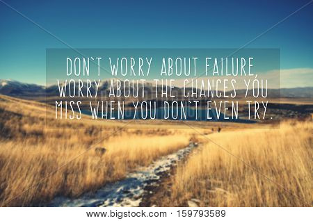 Inspirational life quote - don't worry about failure worry about the chances you you miss when you don't even try. Blurry and vintage style background.