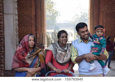 NEW DELHI, INDIA - FEBRUARY 03, 2016 - Unidentified happy indian family take picture inside Qutab minar archaeological site