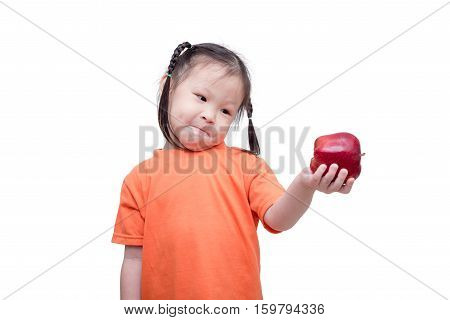 Little asian girl holding an apple over white