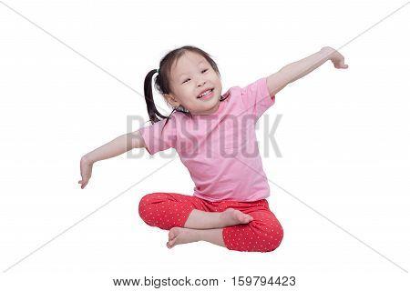 Little asian girl sitting over white background
