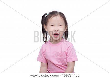 Little asian girl smiling over white background