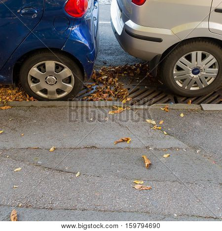 Mansfield Road Oxford United Kingdom October 23 2016: Tightly parked blue and silver cars on Mansfield Road Oxford.