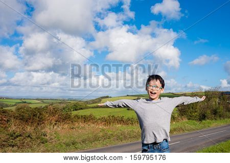Young asian boy feel happy with grass field and sky