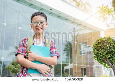 Young Asian student boy smiling at school