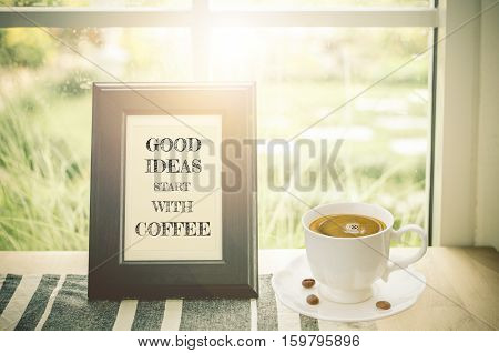 Quote with coffee: Good ideas start with coffee in wooden frame