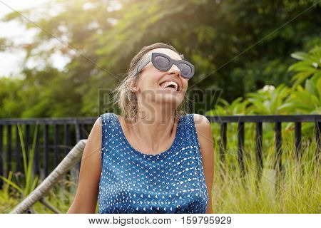 Happy Maternity Concept. Headshot Of Beautiful Pregnant Woman In Shades Spending Nice Time Outside,