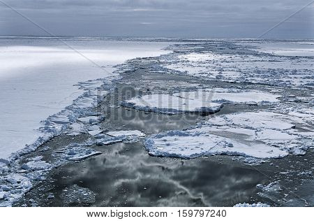 Antarctica, Weddell Sea, Ice floe, clouds reflecting in water