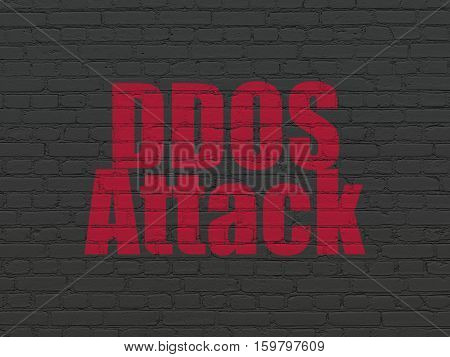 Privacy concept: Painted red text DDOS Attack on Black Brick wall background