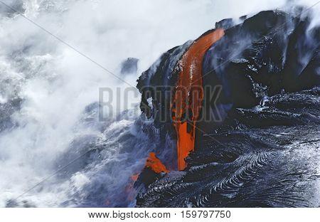 USA, Hawaii, Big Island, Volcanos National Park, cooling lava and surf