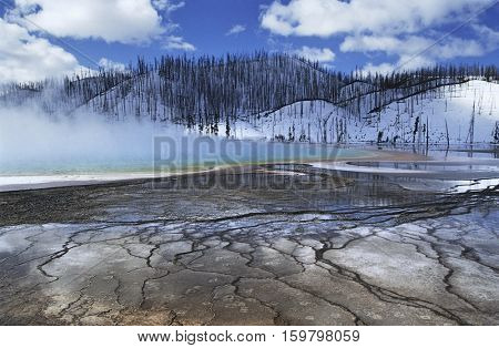 USA, Wyoming, Yellowstone National Park, Grand Prismatic Spring, mist over hot spring in winter landscape