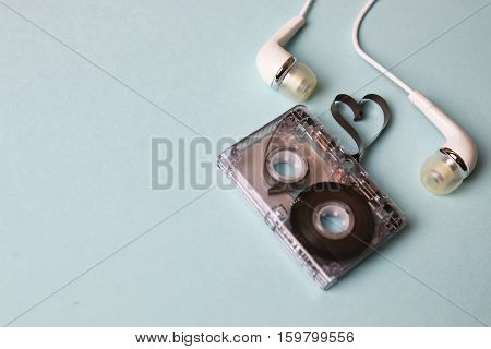 background music accessories paper audiotape and small headphones
