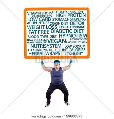 Isolated overweight man with many ways of loosing weight