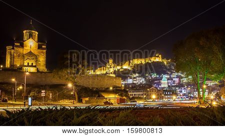 Night View Of The Metekhi Church, The Equestrian Statue Of King Vakhtang Gorgasali And Fortress Nari