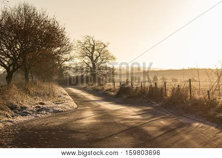 Sunrise over a Frosty Countryside Lane in Oxfordshire UK
