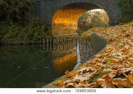 Arch of a bridge over the river thames at St Johns Lock Lechlade on winters morning