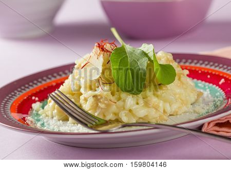 Risotto with mushrooms saffron herbs and parmesan cheese.