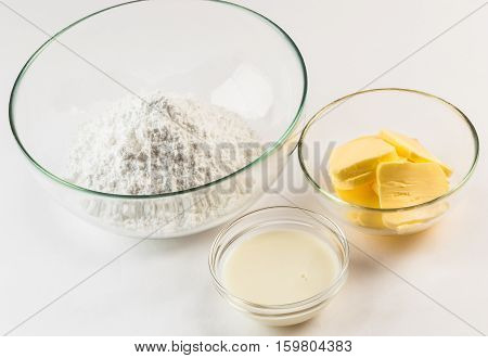 Ingredients for preparing buttercream in glass bowls