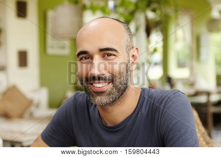 Close Up Shot Of Handsome Caucasian Man With Beard Dressed In T-shirt Looking And Smiling At Camera