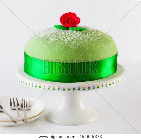 Traditional Swedish princess cake marzipan birthday cake.