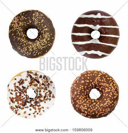 Set of chocolate donuts isolated on white background. Top view.