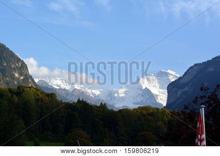 snowy peak of the Jungfrau mountain in daylight