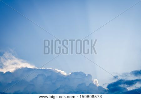 Cloud Shadow with Crepuscular Rays in blue sky