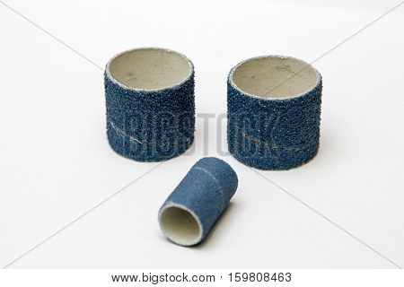 Blue sandpaper spiral band isolated on white.