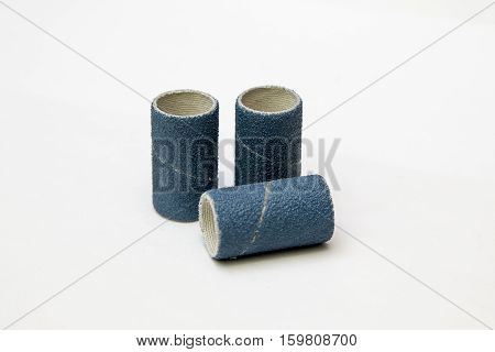 Blue sandpaper spiral band isolated on white. poster