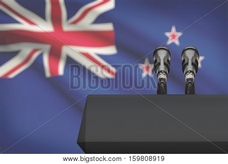 Pulpit And Two Microphones With A National Flag On Background - New Zealand