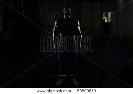 Silhouette Man Exercising Back With Barbell