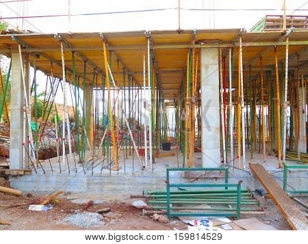 Wooden ceiling held up by Adjustable Heavy Duty Telescopic Formwork Construction Scaffolding Posts ready for pouring concrete floor