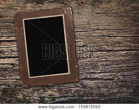 old vintage photos on a wooden background
