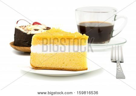 Chiffon cake garnished with foi thong in white plate with chocolate cake and a cup of black coffee on white background
