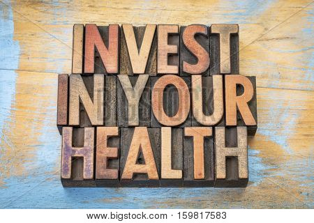 invest in your health - word abstract in vintage letterpress wood type printing blocks