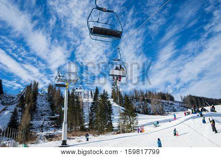HIGH TATRAS STRBSKE PLESOSLOVAKIA - JANUARY 03 2016: Winter mountains panorama with ski slopes and ski lifts