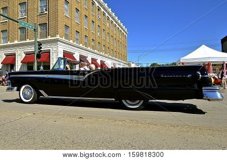 MANDAN, NORTH DAKOTA, July 3, 2016: The 4th of July Rodeo Days  3 day celebration includes the rodeo, Art in the Park, and downtown 4th parade where this black 1958 Ford Fairlane retractable convertible is featured.