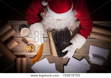Santa Claus working at the table in his room