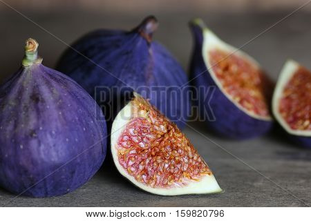 Ripe juicy and healthy oriental fruit figs on a table surface