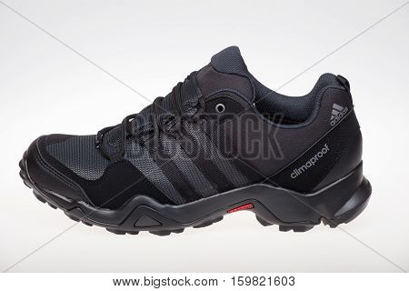 Varna Bulgaria - NOVEMBER 8 2016: Adidas AX2 OUTDOOR PLEIN AIR shoe. Product shot. Adidas is a German corporation that designs and manufactures sports shoes clothing and accessories