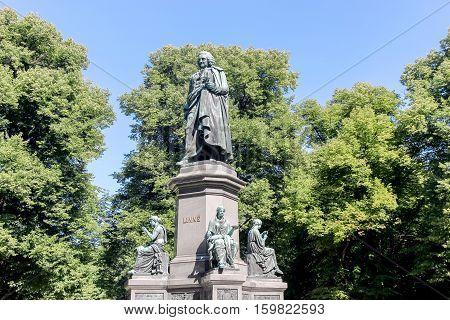 stone sculpture of Carl Linnaeus in park