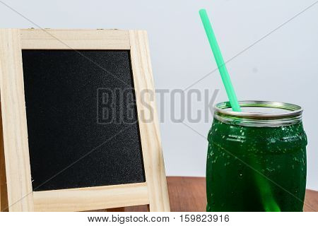 Green apple soda juice and white scene.