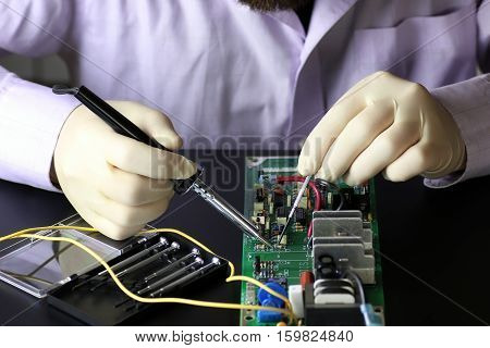 technology engineer of the modern world in a workflow with electronic devices