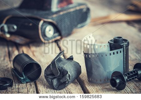 Old photo film rolls and cassette vintage camera on background. Retro toned.