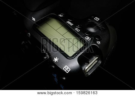 LED display on a DSLR camera, close up image isolated on black background