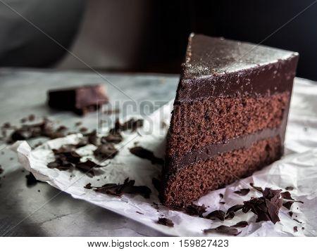 piece of dark chocolate fudge cake selective focus.