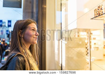 Woman Shopping In London And Looking At A Shop Window