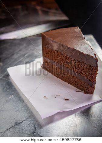 piece of dark chocolate fudge cakeselective focus.
