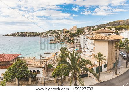 Mallorca view of Cala Mejor beach. Hotels and seaside of this beautiful beach in Majorca. Summer tourism and travel concepts.